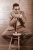DIZZY GILLESPIE postcard with trumpet on stool